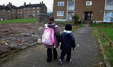 Two children on deprived housing estate