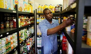 Ransford Amoah helps out at a food bank in Croydon, south London