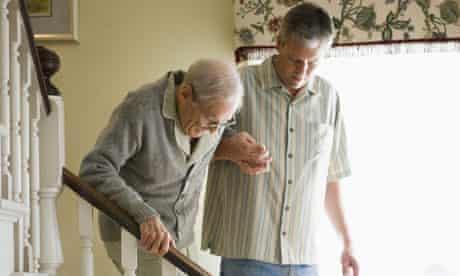 View of man helping feeble senior man walk downstairs. Image shot 2006. Exact date unknown.