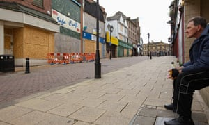 Rotherham high street, man looking fed up