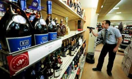 An LCBO employee checks the stock at the Queens Quay liquor store in Toronto.