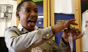 South African activist Noxolo Bunu demonstrates using a female condom