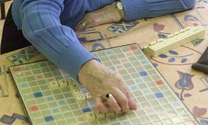 Older woman playing Scrabble