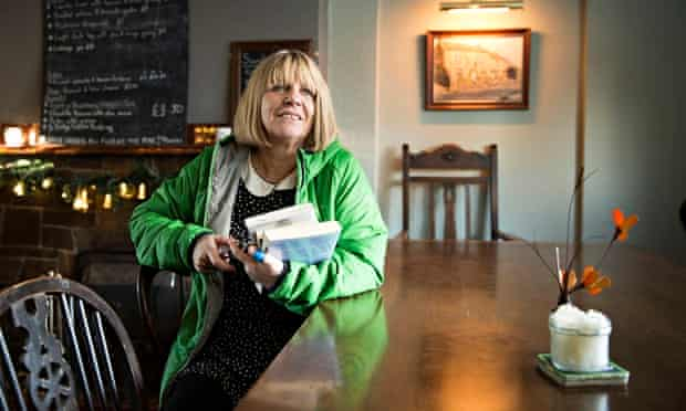 Stephanie Miller borrowing books at the George and Dragon pub in Hudswell, North Yorkshire