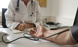 Doctor takes patient's blood pressure