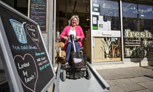 Lynette McMillan leaves the Tasty Bites cafe on her mobility scooter.