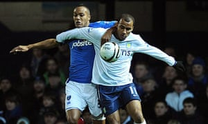 Younes Kaboul, left, battles for possession with Gabriel Agbonlahor