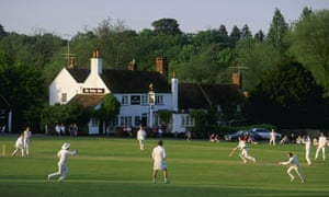 A typical village cricket match in progress at Tilford in Surrey.