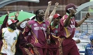 The West Indies team celebrate their victory over India on Friday.