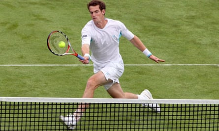 Andy Murray plays a volley playing with Lleyton Hewitt during the men's doubles at Queens