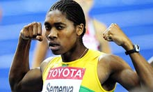 Caster Semenya celebrates after winning 800m gold at the world championships in Berlin.