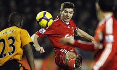Steven Gerrard attempts to control the ball under pressure from Wolves' Ronald Zubar