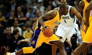 ae5d330253e4 Kobe Bryant dribbles with the ball during the LA Lakers  match against the  Minnesota Timberwolves