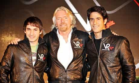 Virgin Racing team owner Richard Branson with drivers Timo Glock, left, and Lucas Di Grassi