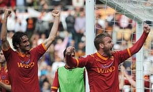 Daniele De Rossi, right, and Luca Toni celebrate Roman's win against Atalanta