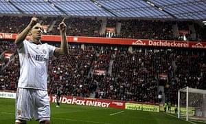 Arjen Robben celebrates scoring for Bayern Munich against Bayer Leverkusen