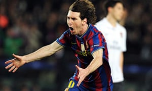 Lionel Messi celebrates scoring his first goal in Barcelona's 4-1 win against Arsenal at Camp Nou