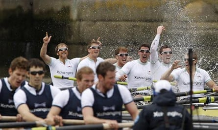Members of the Cambridge University crew celebrate winning the 156th annual Boat Race