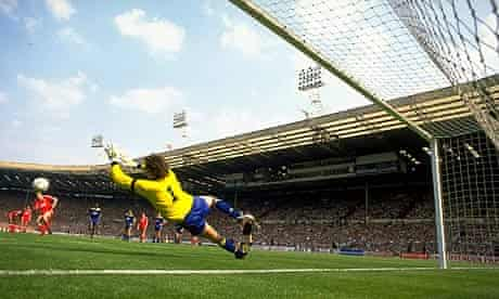 Dave Beasant dives to his left to save a penalty from John Aldridge during the 1988 FA Cup final
