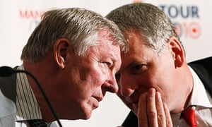 Sir Alex Ferguson, left, speaks with David Gill at a press conference at New York