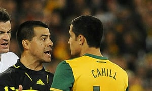 Tim Cahill is reprimanded by the referee following his tackle on New Zealand's Leo Bertos