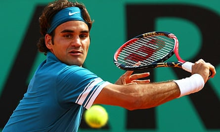 Roger Federer plays a backhand during his second-round win at the French Open