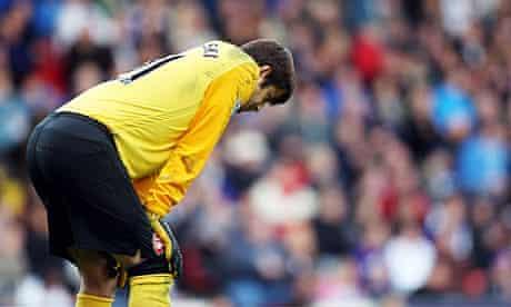 Lukasz Fabianski contemplates his errors in the Arsenal goal