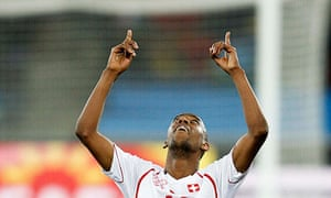 Gelson Fernandes celebrates scoring the winning goal for Switzerland against Spain