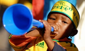 A young South African fan plays a vuvuzela