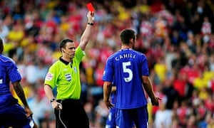 Gary Cahill, right, is sent off by Stuart Atwell at the Emirates Stadium on Saturday