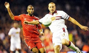 Andrew Holt clears the ball under pressure from Ryan Babel during Northampton's win over Liverpool