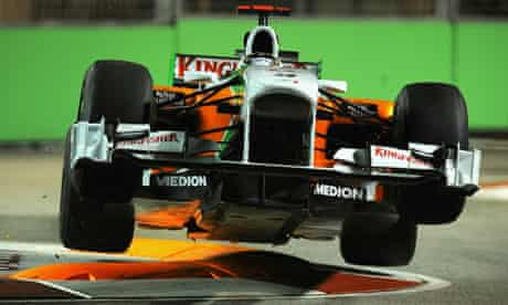 Adrian Sutil in his Force India as he hits a curb during practice for the Singapore grand prix