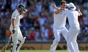Chris Tremlett is congratulated by Graeme Swann after taking the wicket of Australia's Brad Haddin