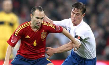 Scott Parker get to grips with Spain's Andrés Iniesta