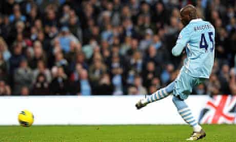 Manchester City's Italian striker Mario Balotelli scores his penalty against Newcastle United