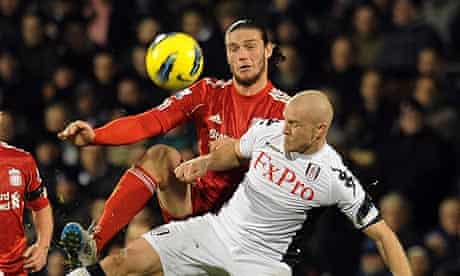 Liverpool's Andy Carroll with Philippe Senderos of Fulham