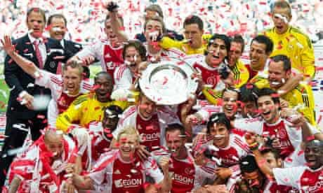 Ajax's players celebrate with the Eredivisie trophy