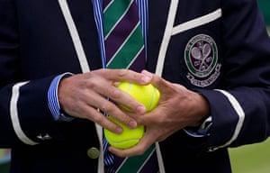 Wimbledon photo book: A referee checks the balls before a Wimbledon members test game on Court 2