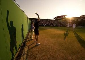 Wimbledon photo book: Sun set over court 5 during a mixed doubles match