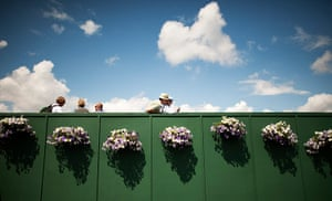 Wimbledon photo book: Spectators with flowers during Wimbledon tennis championships
