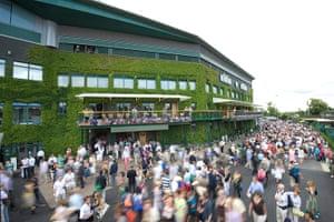 Wimbledon photo book: Crowds swarm around in front of centre court