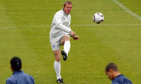 England's coach Stuart Pearce kicks the ball during a training session in Fredericia