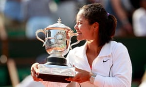 Li Na of China poses with the trophy after winning the French Open in Paris