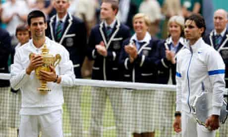 Novak Djokovic holds the Wimbledon trophy