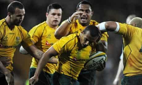 Australia's Will Genia, centre, is congratulated by team-mates