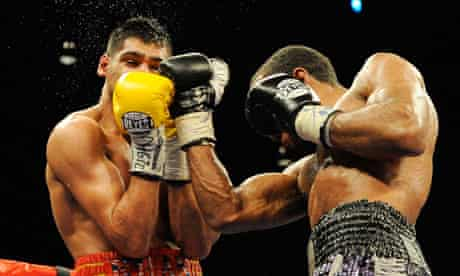 Amir Khan, left, was beaten by Lamont Peterson following a controversial decision