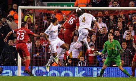 Swansea City's Chico Flores, No 4, scores against Liverpool