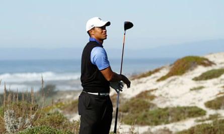 Tiger Woods hits his tee shot at the sixth