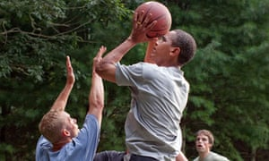 President Barack Obama plays basketball with White House staff in August 2009