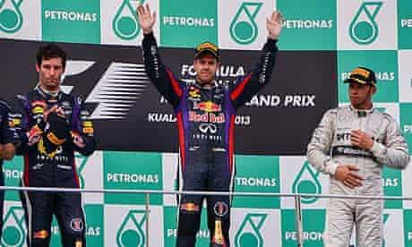 Lewis Hamilton, right, on the Sepang podium with Sebastian Vettel and Mark Webber